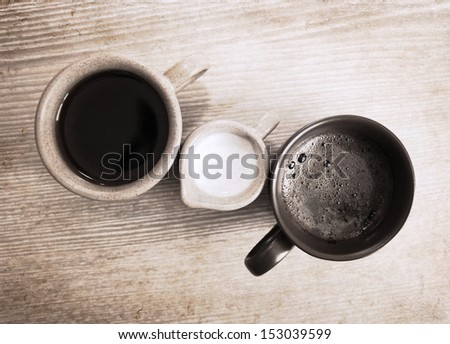 artwork  in grunge style,  two cup of coffee and milk jug