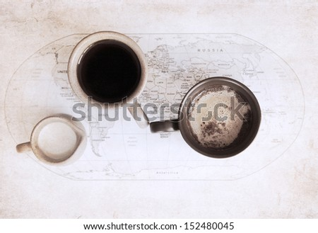artwork  in grunge style,  two cups of coffee, world political map, and milk jug  - stock photo