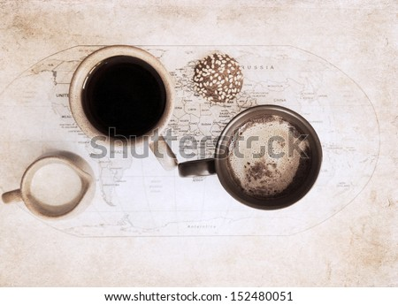 artwork  in grunge style,  two cups of coffee, world political map, milk jug and cookie - stock photo