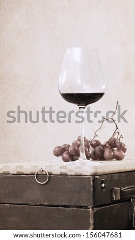 Artwork in retro style, glass of red wine and grapes