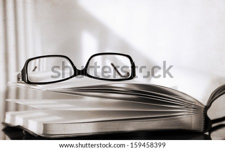 Artwork in retro style, glasses and book - stock photo