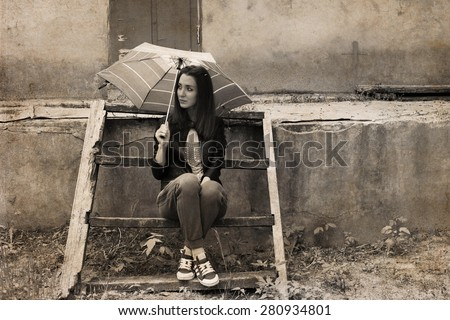 Artwork in retro style, young woman with umbrella sitting near the old house