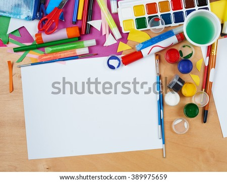 artwork workplace with creative accessories, art tools for painting and drawing - stock photo