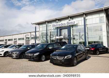 ARTYOM, RUSSIA - CIRCA AUGUST, 2015: Cars at the dealership of Mercedes-Benz for the city of Vladivostok. Mercedes-Benz - brand cars premium class, trucks and buses German concern Daimler AG - stock photo