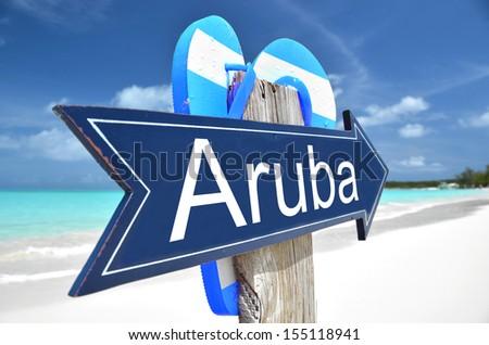Aruba arrow on the beach - stock photo