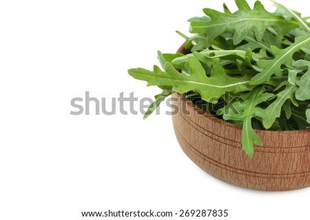 arugula in a saucer isolated - stock photo