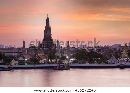 Arun temple with Bangkok main river and beautiful sky background after sunset, The most tourist destination of Thailand - stock photo