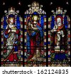 ARUNDEL - AUGUST 10: Stained Glass window depicting Solomon, David and Hezekiah in Saint Nicholas Church, Arundel, West-Sussex, United Kingdom on August 10, 2013. - stock photo