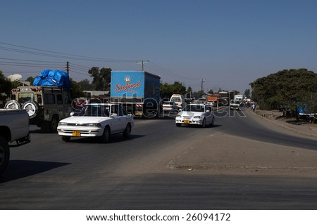 ARUSHA, TANZANIA - JAN 3: Traffic on a main road from town on January 3, 2009 in Arusha, Tanzania. Arusha is located 1400 meters above sea-level at the foot of Mount Meru.