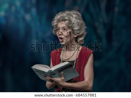As a grandmother disguised girl reads  from a book to the audience.