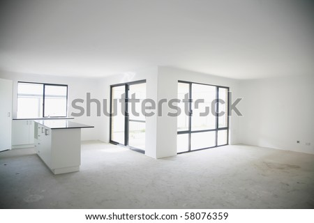 As above - black stone kitchen bench top, unfinished flooring, white wall. - stock photo