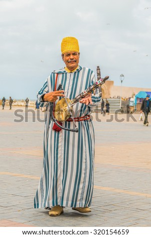 AS-SAWIRA, MOROCCO, APRIL 7, 2015: A local man plays traditional Berber instrument - stock photo