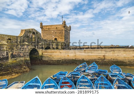 AS-SAWIRA, MOROCCO, APRIL 7, 2015: Blue fishing boats moor in port - stock photo
