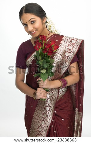Asain girl with red silk sari and red roses - stock photo