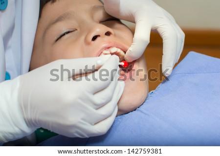 Asain kid at the dentist clinic. - stock photo