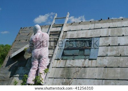 Asbestos removal worker. Dangerous waste disposal - professional works with old architecture. - stock photo