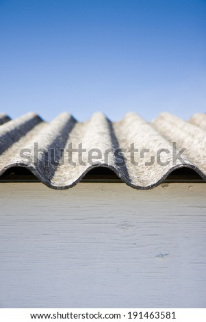 Asbestos roof. Medical studies have shown that the asbestos particles can cause cancer. - stock photo