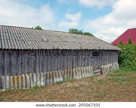 Asbestos tiles on the old country barn roof       - stock photo