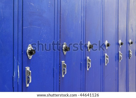 Ascending Blue High School Lockers with a spin dial for the combination code.