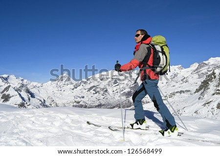 Ascending to the top. Ski mountaineering cross country skiing in Italian Alps, Cervino Matterhorn - stock photo
