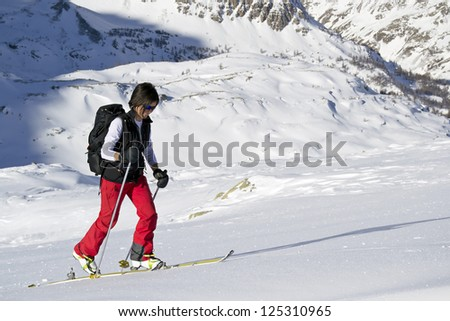 Ascending to the top. Ski mountaineering or cross country skiing in Italian Alps (Gran Paradiso National Park) - stock photo