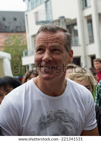 ASCHAFFENBURG, GERMANY -SEPTEMBER, 2014: German former boxing champion Henry Maske at a autograph session for fans on September 20, 2014 in Aschaffenburg, Germany
