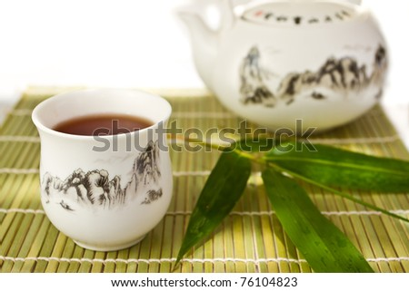 asean cup of tea and pot on the bamboo mat - stock photo