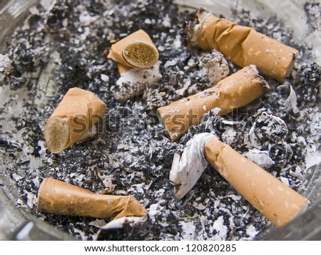 ash-tray with many stubs and cigar-butts - stock photo