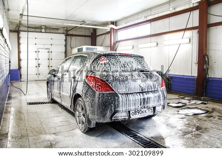 ASHA, RUSSIA - JANUARY 19, 2012: Motor car Peugoet 308 at the car wash service station. - stock photo