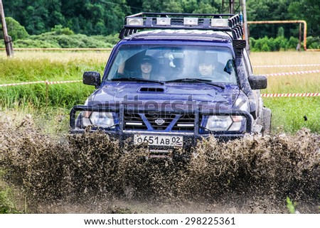 ASHA, RUSSIA - JULY 18, 2015: Off-road vehicle Nissan Patrol at the dirt road. - stock photo