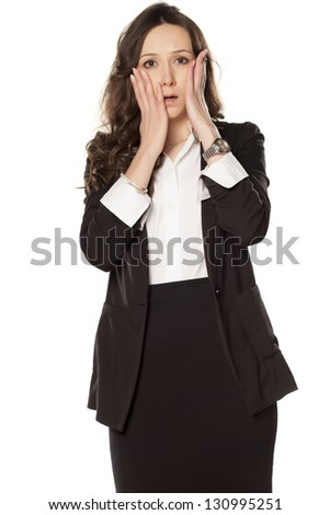 ashamed business woman posing on a white background - stock photo