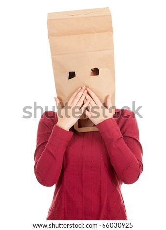 ashamed young woman in ecological paper bag on head