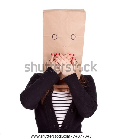 ashamed young woman in sad ecological paper bag on head, series - stock photo