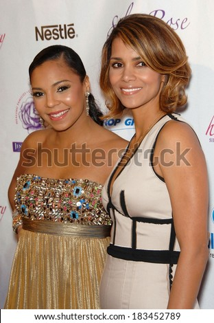 Ashanti, Halle Berry at Silver Rose Gala and Auction Benefit, Beverly Hills Hotel and Bungalows, Los Angeles, CA April 18, 2009 - stock photo