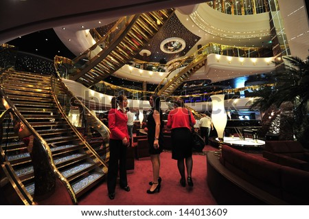 ASHDOD, ISR - MAR 09:Passengers on board  MSC - SPLENDIDA on March 09 2010.It's on of the most luxurious ship sail in the Mediterranean sea. It can accommodate 4000 passengers and 2000 crew members. - stock photo