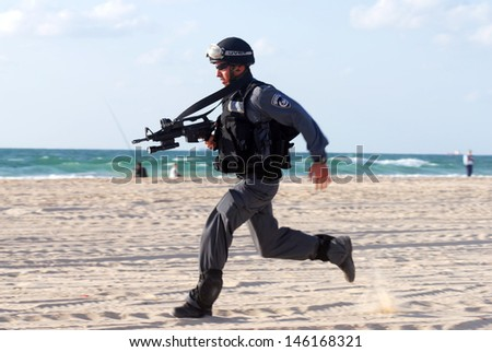 ASHDOD,ISR - SEP 09:Yamam unit simulate sea terror attack on Israeli beach on Sep 09 2007.It capable of both hostage-rescue operations and offensive take-over raids against targets in civilian areas. - stock photo
