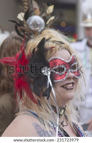 Asheville, North Carolina, USA - March 2, 2014: Close up of a mysterious masked woman in a colorful Mardi Gras costume in the annual Mardi Gras Parade on March 2, 2014 in downtown Asheville, NC