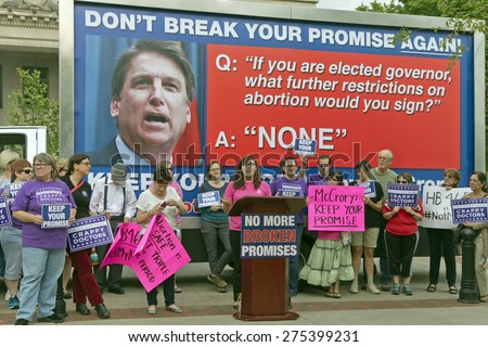 Asheville, North Carolina, USA - May 4, 2015:  Crowd holds signs asking NC Governor McCrory to keep his promise not to further restrict access to abortion at a rally protesting NC abortion bill #465 - stock photo