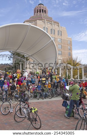 Asheville, North Carolina, USA - November 8, 2014:  Bicyclists dressed in Halloween costumes get ready to ride their bicycles in the annual Pumpkin Pedaler event in downtown Asheville's Pack Square  - stock photo