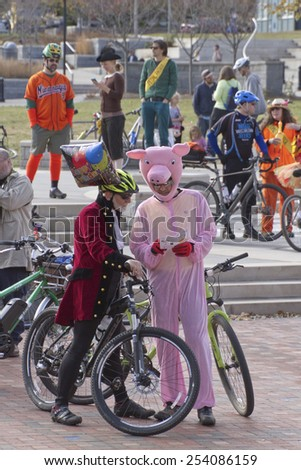 Asheville, North Carolina, USA - November 8, 2014: Creatively costumed bicyclists wait for the Pumpkin Pedalers event ot begin on November 8, 2014 in downtown Asheville, NC  - stock photo