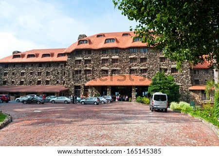 Asheville - SEP 3: The Omni Grove Park Inn Resort Hotel on September 3 2013 in Asheville, North Carolina. The old historic hotel opened in 1913 and has been visited by many United States presidents. - stock photo