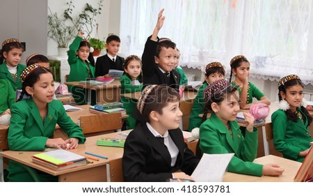Ashgabad, Turkmenistan - November 4, 2014. Group of students in lesson in the classroom . November 4, 2014.  In schools of Turkmenistan annually trains about 900 thousand children. - stock photo