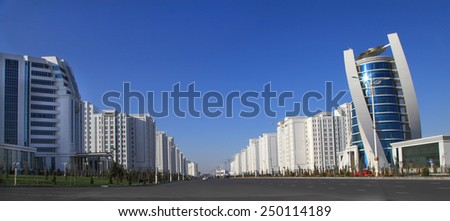 Ashgabat, Turkmenistan - October 15, 2014: Modern architecture of Ashgabat. Wide boulevard with some new buildings. Ashkhabad. Turkmenistan in October 15, 2014.