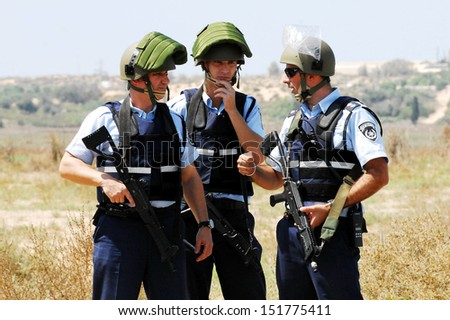 ASHKELON, ISR - SEP 10:Israeli police forces simulate a bomb truck attack in Israel on September 10 2008.The Israel Police are a professional force, with some 35,000 persons on the payroll. - stock photo