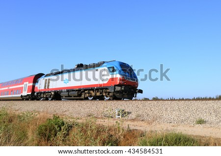ASHKELON, ISRAEL- JUNE 06, 2016:Train on a rout Ashkelon-Ashdod.The current generation can be run at speeds up to 160 km/h (99.4 mph)and each coach can seat 100 to 150 passengers. - stock photo
