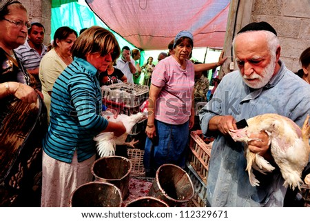 ASHKELON - SEPTEMBER 22: Ultra-orthodox Jew does ritual Kapparot - kills a chicken. on September 22, 2009 in Ashkelon, Israel - stock photo
