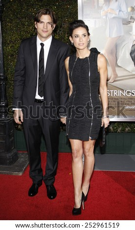 """Ashton Kutcher and Demi Moore at the Los Angeles Premiere of """"No Strings Attached"""" held at the Regency Village Theatre in Westwood, California, United States on January 11, 2010.  - stock photo"""