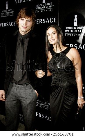 Ashton Kutcher and Demi Moore attend the Rodeo Drive Walk Of Style Award honoring Gianni and Donatella Versace held at the Beverly Hills City Hall in Beverly Hills, California on February 8, 2007.  - stock photo