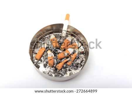 Ashtray and cigarette on a white background. - stock photo