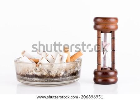 ashtray and cigarettes on white background - stock photo